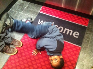 This is my child, on the floor of the elevator at the Hampton Inn Vancouver. I feel OK about not taking him to Paris.