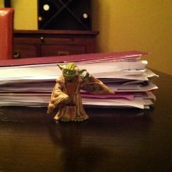 This is six weeks of kindergarten schoolwork. Action figure Yoda for scale.
