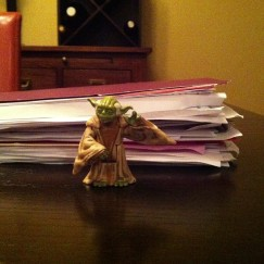 This is six weeks of kindergarten schoolwork. Action figure Yoda for scale.