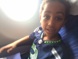 Bini, rocking his Seahawks jersey (and a window seat) on the first flight.