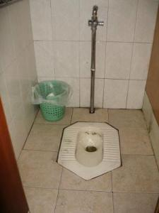 While this is not the toilet in my Chinese toilet story, mine looked very similar. Except way grosser. (Image courtesy of about.com)