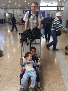 How to occupy your kids while waiting (and waiting) for your bags in Beijing. Doesn't Steve look thrilled?